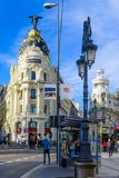 Metropolis building, in Madrid. MADRID, SPAIN - JANUARY 1, 2018: View of Alcala street, with the Metropolis building, locals and visitors, in Madrid, Spain stock image