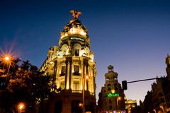 Metropolis building in Madrid at sunset Stock Image