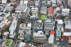 The metropolis. Fragment of dense housing metropolis of skyscraper windows. Japan Royalty Free Stock Photos