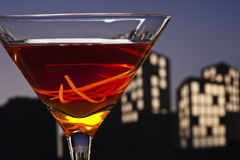 Metropolis Manhattan cocktail in city skyline setting Royalty Free Stock Photography