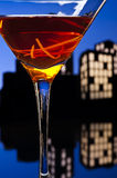 Metropolis Manhattan cocktail in city skyline setting Royalty Free Stock Images