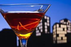 Metropolis Manhattan cocktail in city skyline setting stock photography