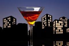 Metropolis Manhattan cocktail in city skyline setting Royalty Free Stock Photos