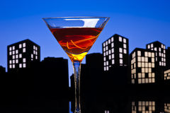 Metropolis Manhattan cocktail in city skyline setting Royalty Free Stock Photo