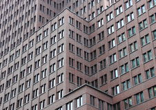 Metropolis modern building facade in different levels. With red bricks royalty free stock images