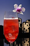 Metropolis Singapore Sling cocktail in city skyline setting Royalty Free Stock Photo