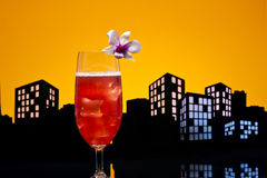 Metropolis Singapore Sling cocktail in city skyline setting Stock Photos