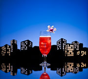 Metropolis Singapore Sling cocktail in city skyline setting Stock Photo