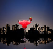 Metropolis strawberry Margarita cocktail. In city skyline setting stock photos