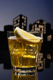 Metropolis Whisky sour cocktail. In city skyline setting royalty free stock photo
