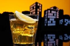 Metropolis Whisky sour cocktail. In city skyline setting stock photos