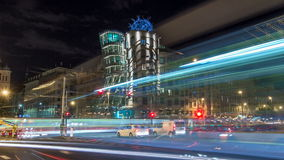 Metropolises Prague at night timelapse hyperlapse in the twilight, modern architecture, Dancing house, Czech republic. Traffic on the road and trams stock video