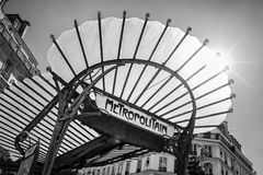 Metropolitain art nouveau sign with a glass roof in Paris France. Black and white royalty free stock image