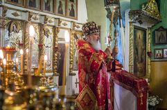 The Metropolitan celebrated the divine Liturgy in the Russian Orthodox Church. Service of Liturgy and the rank of consecration of honey in the Orthodox Church stock image
