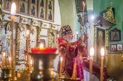 The Metropolitan celebrated the divine Liturgy in the Russian Orthodox Church. Service of Liturgy and the rank of consecration of honey in the Orthodox Church royalty free stock photo