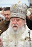 Metropolitan Irenaeus sanctifies water Royalty Free Stock Photos