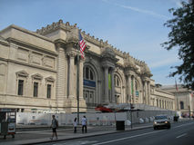 The Metropolitan Museum of Art New York. The facade of the Metropolitan Museum of Art with its columns, arches and an american flag, Manhattan Island, New York Royalty Free Stock Images