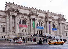 Metropolitan Museum New York City. The facade of the metropolitan museum of art, a yellow cab and the tourists Stock Photography