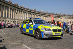 Metropolitan police car escorts Olympic torch relay,Bath,Somerset,UK Stock Photos