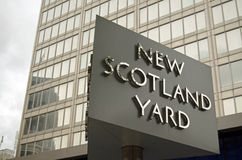 Metropolitan Police Headquarters. LONDON, UK - MAY 7, 2015: Sign outside the headquarters of London's Metropolitan Police in New Scotland Yard, Westminster. The stock image