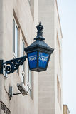 Metropolitan Police lantern in London. Close-up of a traditional police lantern, on display outside a metropolitan police station in the center of London Royalty Free Stock Photography