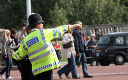 Metropolitan police officer giving directions stock photo