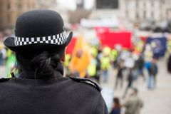 Metropolitan Police officer at a protest demonstration in central London, England. stock photo