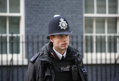 Metropolitan Policewoman on duty in London Stock Photos