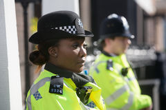 Metropolitan Policewoman on duty in London. LONDON, UK - Apr 19, 2017: Metropolitan policewoman on duty at 10 St James`s Square The Royal Institute of Stock Photos