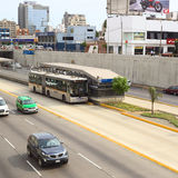 Metropolitano Bus in Lima, Peru. LIMA, PERU - FEBRUARY 13, 2012: Metropolitano bus of the Line B stopping at the crossing of the Avenues Ricardo Palma and Paseo Royalty Free Stock Image