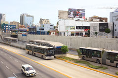 Metropolitano Bus in Lima, Peru. LIMA, PERU - FEBRUARY 13, 2012: Metropolitano bus of the Line A stopping at the crossing of the Avenues Ricardo Palma and Paseo Royalty Free Stock Photos