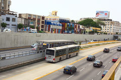 Metropolitano Bus in Lima, Peru. LIMA, PERU - FEBRUARY 13, 2012: Metropolitano bus stopping at Ricardo Palma Avenue in Miraflores on February 13, 2012 in Lima Stock Photo