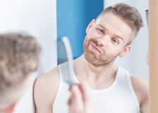 Metrosexual guy in the bathroom Royalty Free Stock Photo