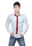 Metrosexual, handsome chinese hunk in white shirt. Jeans, red tie Stock Photo