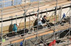 Metselaars op het Werk Stock Afbeelding