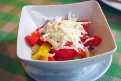 Metta con differenti insalate su fondo bianco Immagine Stock Libera da Diritti