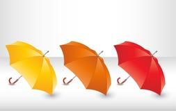 Metta con gli ombrelli Fotografia Stock
