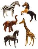 Metta con le figurine degli animali africani Immagini Stock Libere da Diritti