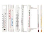 Metta dei termometri isolati su bianco fotografie stock