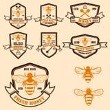 Metta del modello d'annata delle etichette del miele Icone dell'ape Progetti l'elemento per il logo, l'etichetta, l'emblema, il s fotografie stock