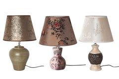 Metta delle lampade da tavolo isolate su fondo bianco immagini stock libere da diritti