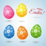 Metta delle uova di Pasqua luminose decorative in un fiore su un elemento leggero del fondo per la progettazione delle cartoline  illustrazione di stock