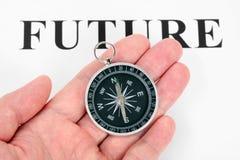 Metta in evidenza il futuro e la bussola Immagini Stock Libere da Diritti