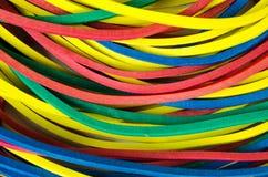 Metta gli elastici della cancelleria come fondo Fotografia Stock Libera da Diritti