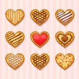 Metta i biscotti del cuore Fotografie Stock Libere da Diritti