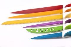Metta i coltelli di colore Fotografie Stock