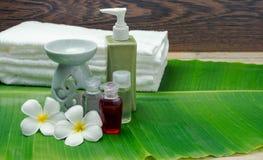 Metta i dispositivi di massaggio su un fondo vago Fotografia Stock