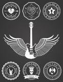 Metta i distintivi di musica rock e del rock-and-roll Immagine Stock