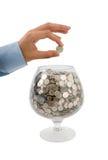 Metta i soldi in vetro Fotografia Stock Libera da Diritti