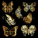 Metta le farfalle dell'oro Fotografia Stock